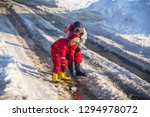 two boys in rainboots playing... | Shutterstock . vector #1294978072