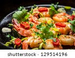 Closeup of shrimps on pan with garlic - stock photo