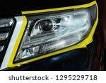 polishing the optics of car... | Shutterstock . vector #1295229718