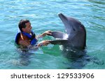 Happy Man Swim With Dolphin In...