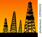 oil rig silhouettes and orange... | Shutterstock .eps vector #129534152