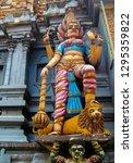 hindu deity on the facade of a... | Shutterstock . vector #1295359822