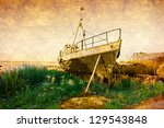 old rusty boat at seashore with ... | Shutterstock . vector #129543848