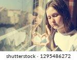 attractive sad teenage girl... | Shutterstock . vector #1295486272
