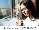 attractive sad teenage girl... | Shutterstock . vector #1295487502