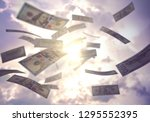 raining money from the sky ... | Shutterstock . vector #1295552395
