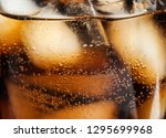 glass of tasty refreshing cola... | Shutterstock . vector #1295699968