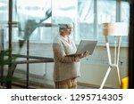 light spacious office. pregnant ... | Shutterstock . vector #1295714305