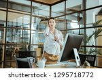 light spacious office. young... | Shutterstock . vector #1295718772