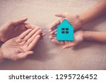adult and child hands holding... | Shutterstock . vector #1295726452