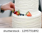 confectioner decorates white... | Shutterstock . vector #1295751892