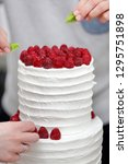 confectioner decorates white... | Shutterstock . vector #1295751898