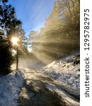 sunbeams on a mountain road in...   Shutterstock . vector #1295782975