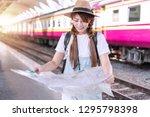 traveler woman wearing white t... | Shutterstock . vector #1295798398