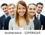 happy businesswoman looking at... | Shutterstock . vector #129584165