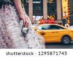 female hand with a retro camera ... | Shutterstock . vector #1295871745