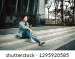 woman using smartphone on street | Shutterstock . vector #1295920585