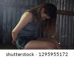 sad victim woman hands tied by... | Shutterstock . vector #1295955172