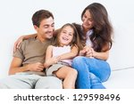 smiling family playing together ... | Shutterstock . vector #129598496