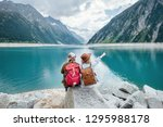 travelers couple look at the... | Shutterstock . vector #1295988178
