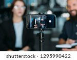 business man and woman shooting ... | Shutterstock . vector #1295990422