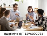 skeptical caucasian colleagues... | Shutterstock . vector #1296002068