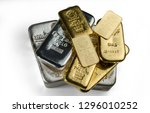 Kyiv, Ukraine - December 05, 2018: A pile of gold and silver bars from different manufacturers lies on a white background. - stock photo