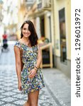 smiling young woman with blue... | Shutterstock . vector #1296013972