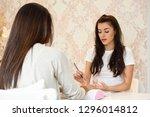 beautician applying cream on... | Shutterstock . vector #1296014812