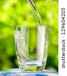 glass of water on nature... | Shutterstock . vector #129604205