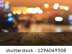 empty dark wooden table in... | Shutterstock . vector #1296069508