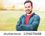 sportive man portrait outdoor... | Shutterstock . vector #1296078688