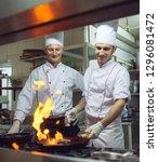 fire in the kitchen. fire gas...   Shutterstock . vector #1296081472