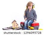 little girl builder sitting on... | Shutterstock . vector #1296095728