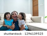 dad and his two little girls...   Shutterstock . vector #1296139525