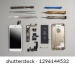 broken smartphone disassembled... | Shutterstock . vector #1296144532