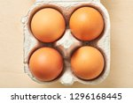 four raw egg in packing on... | Shutterstock . vector #1296168445