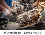closeup repair of an opposing... | Shutterstock . vector #1296174148
