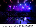 Stock photo dj spinning mixing and scratching in a night club strobe lights and fog selective focus close 1296186958
