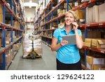 businesswoman using digital... | Shutterstock . vector #129624122