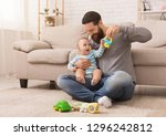 happy father playing with his... | Shutterstock . vector #1296242812