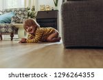 smiling kid sitting on floor at ... | Shutterstock . vector #1296264355