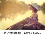 Asian Woman Sitting On Wooden...