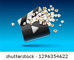 cinema clapper with popcorn... | Shutterstock .eps vector #1296354622