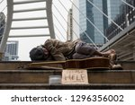 old homeless dirty man get cold ... | Shutterstock . vector #1296356002