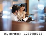 Stock photo young male manager working in modern office cafeteria and meeting female colleague busy business 1296485398