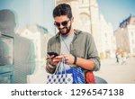 man in shopping. smiling man... | Shutterstock . vector #1296547138