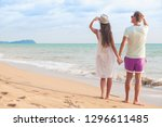back view of couple sitting on... | Shutterstock . vector #1296611485