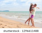 back view of couple sitting on... | Shutterstock . vector #1296611488