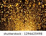 sparkling golden dust   bokeh...   Shutterstock . vector #1296625498